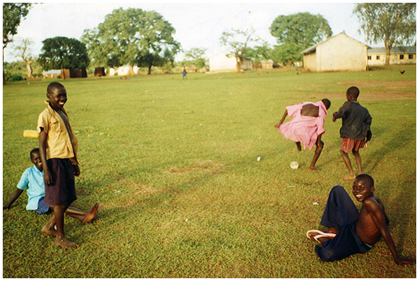 Children playing soccer in Adwila, Uganda